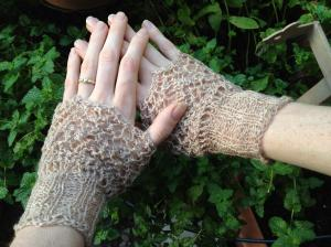 Knit lace cuffs worn as fingerless mitts...