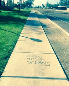 """Follow your dreams"" sidewalk graffiti"